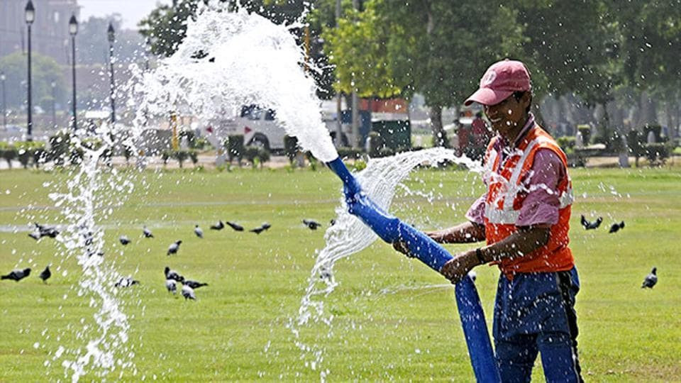 A-worker-waters-a-lawn-near-India-Gate-in-the-scorching-heat-of-New-Delhi-HT-Photo