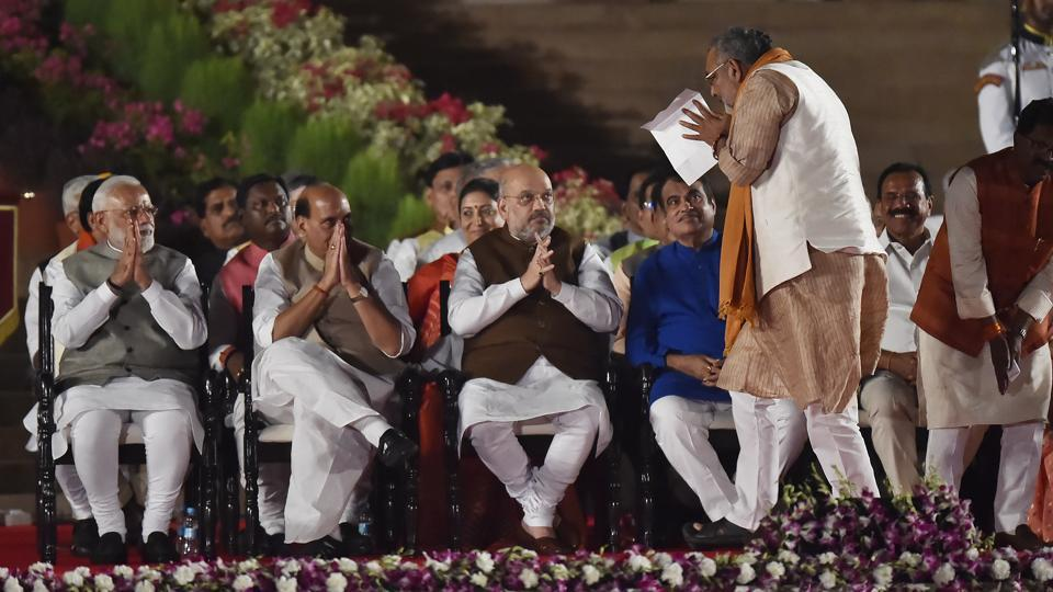 Bharatiya Janata Party leader Giriraj Singh greets Narendra Modi,  Amit Shah, Rajnath Singh as he arrives to take oath as Cabinet minister during the swearing-in ceremony of the NDA government, Rashtrapati Bhavan, May 30, 2019