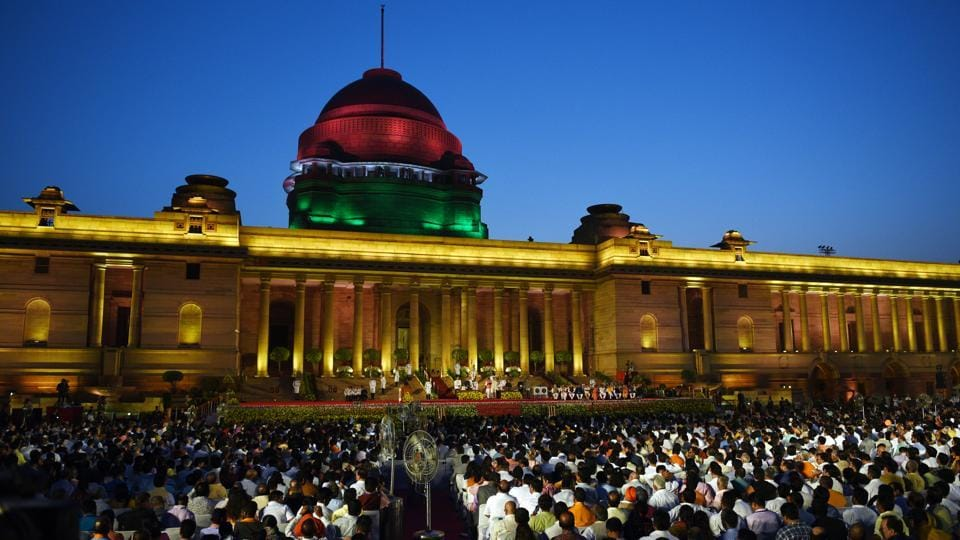 The forecourt of Rashtrapati Bhavan, overlooked by the dome of the President's residence was lit up in the colours of the national flag for the occasion, hosted an audience of around 7000 people including politicians, businessmen and movie personalities for the swearing-in ceremony of Narendra Modi's second government. (Ajay Aggarwal / HT Photo)