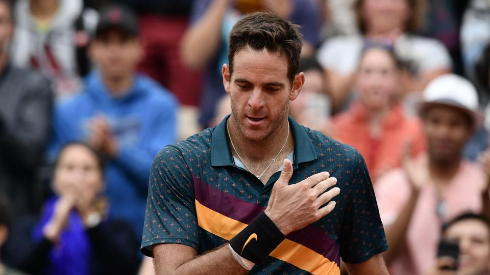 Argentina's Juan Martin del Potro makes the sign of the cross as he celebrates after winning against Japan's Yoshihito Nishioka during their men's singles second round match on day five of The Roland Garros 2019 French Open tennis tournament in Paris on May 30, 2019.