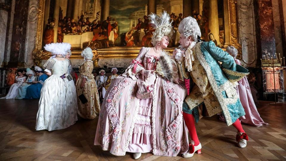 """An Italian Venetian couple dressed in period costumes pose as they take part in the """"Fetes Galantes"""" fancy dress evening at the Chateau de Versailles in France. (Ludivoc Marin / AFP)"""