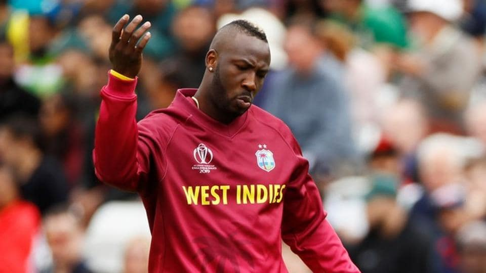 ICC Cricket World Cup - West Indies v Pakistan - Trent Bridge, Nottingham, Britain - May 31, 2019 West Indies' Andre Russell signals for treatment