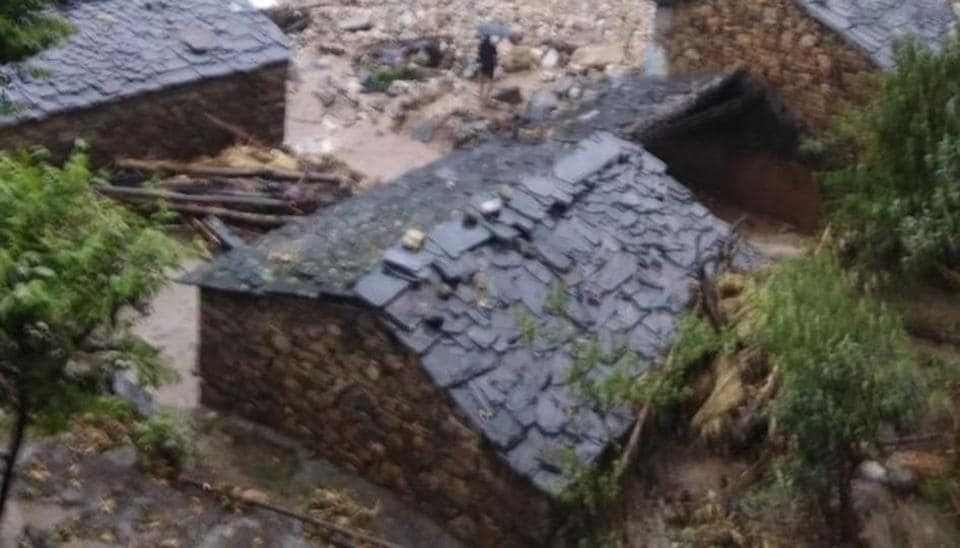 Damaged houses in Almora in Uttarakhand after a clouburst  triggered a flash flood in the district on Sunday.