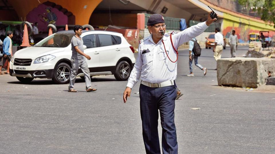 """For Dinesh Bhatnagar (25), a food delivery man working with an app-based company, his worst nightmare in this heat is getting stuck in traffic. """"I shudder each time I see a green signal turning red from a distance."""