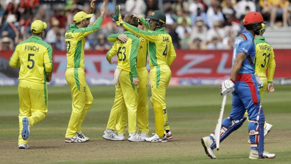 Australia's Alex Carey, fifth left, celebrates stumping the wicket of Afghanistan's Hashmatullah Shahidi. (AP)