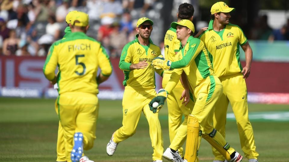 Australia's Marcus Stoinis celebrates with teammates the wicket of Afghanistan's captain Gulbadin Naib. (AFP)