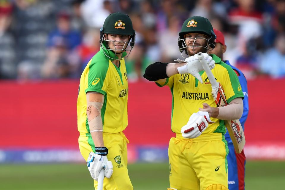 Australia's David Warner (R) and Australia's Steve Smith discuss during the 2019 Cricket World Cup group stage match. (AFP)