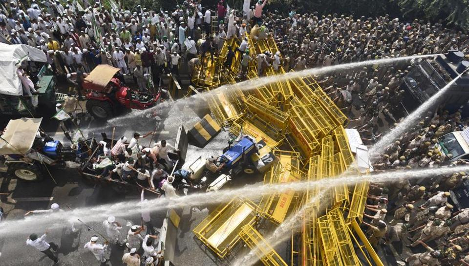 Thousands of farmers clashed with the police and paramilitary forces at the national capital's borders with Uttar Pradesh, prompting police to use tear gas, water cannons to stop protesting farmers from entering the city, at Delhi-Ghaziabad border, New Delhi, India, on Tuesday, October 2, 2018.