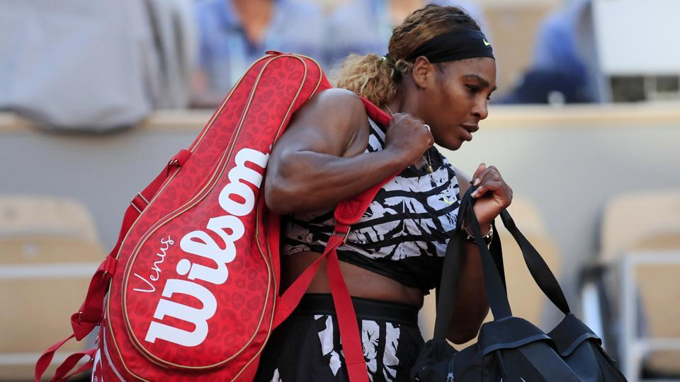 Serena Williams of the U.S. leaves the court after losing her third round match against Sofia Kenin.