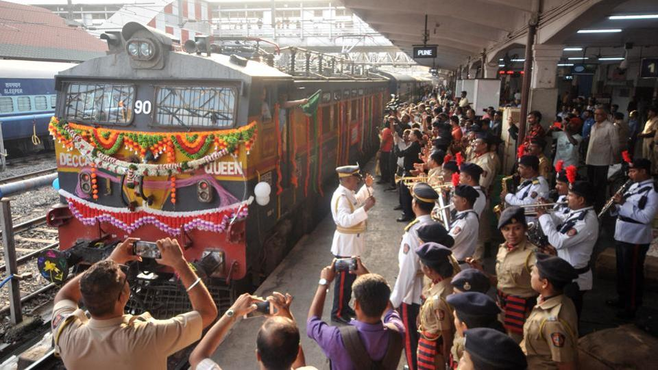 People celebrate the Pune-Mumbai Deccan Queen's 90th year in service at Pune railway station in Pune on June 1. The introduction of ''Deccan Queen'' between the two premier cities of Maharashtra on 1st June 1930 was a major landmark in the history of the Great Indian Peninsula (GIP) Railway, the forerunner of the Central Railway. (HTPhoto)