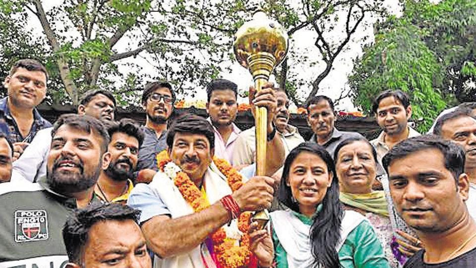 New Delhi, India - May 24, 2019: Bharatiya Janata Party (BJP) candidate from North East Delhi, Manoj Tiwari holds a mace as he celebrates his victory in the Lok Sabha elections, at his residence, in New Delhi, India, on Friday, May 24, 2019. (Photo by Sanjeev Verma / Hindustan Times)