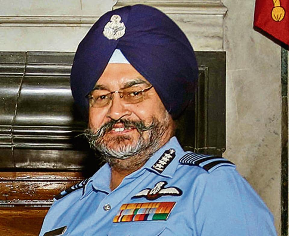 Chief of the Air Staff, Air Chief Marshal BS Dhanoa, receives the Chairman Chiefs of Staff Committee (COSC) baton from outgoing Chief of the Naval Staff Admiral Sunil Lanba in a ceremony, at South Block in New Delhi.