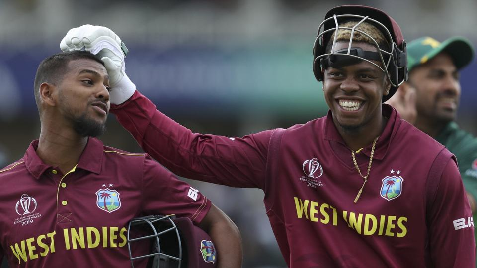 West Indies' Nicholas Pooran, left, and teammate Shimron Hetmyere leave the field.