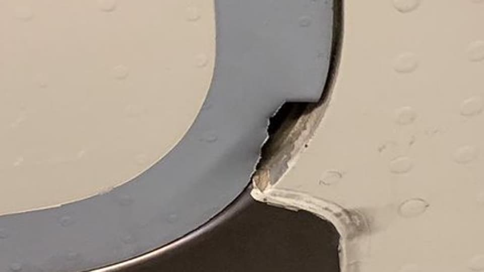 The cause of the hole is yet to be ascertained, an airline official said, adding that it could be due to a foreign object hitting the door during flight.