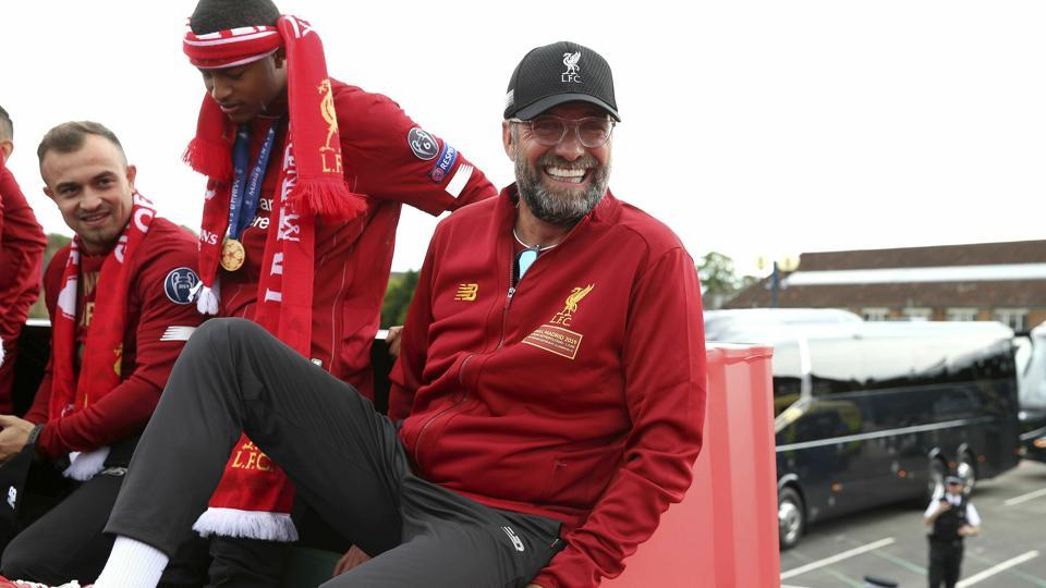 Liverpool soccer team manager Jurgen Klopp, rides an open top bus during the Champions League Cup Winners Parade in Liverpool, England, Sunday June 2, 2019. Liverpool is champion of Europe for a sixth time after beating Tottenham 2-0 in the Champions League final played in Madrid Saturday