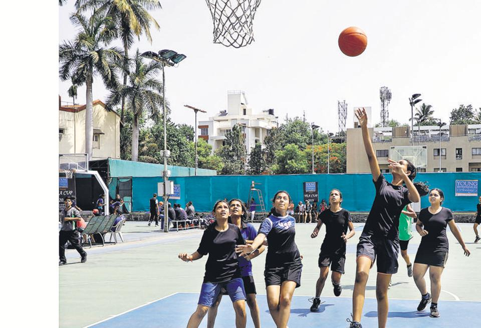Players of GG International School and Amanora Basketball Club (Blue) in action during the ongoing league stage of the YEA Cup basketball tournament at Deccan Gymkhana on Saturday.