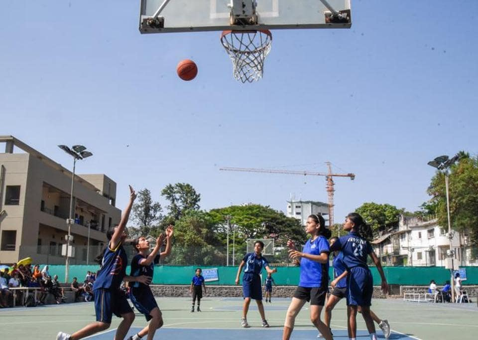 A match in progress between Amanora Basketball Club (Navy blue)and Millennium National School (dark blue) during the league match of YEA Cup Basketball tournament at Deccan Gymkhana basketball court on Sunday.