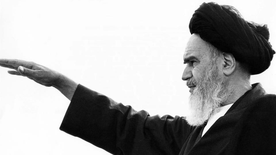 """Ayatollah Ruhollah Khomeini salutes his followers in the Iranian capital Tehran on September 26, 1980. """"His key legacy is the strong notion of independence, sovereignty and resilience against foreign hegemony and imperialism that still continues to exist among Iranians,"""" Mohammad Marandi, head of the American studies department at Tehran University, told AFP. (Stig Nilsson / AFP File)"""