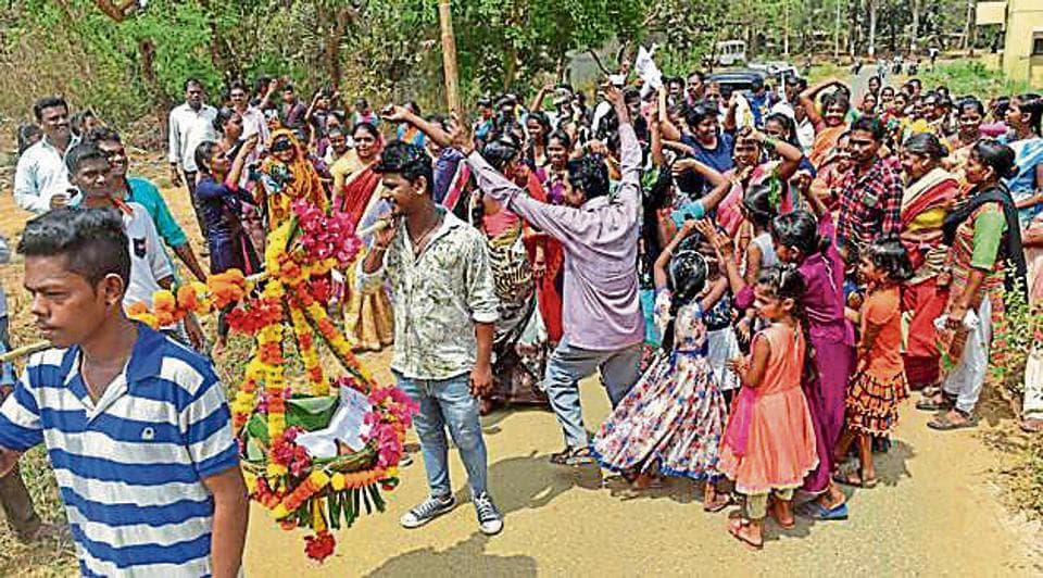 Adivasis of Nausachapada celebrate after getting NOC from Bombay Veterinary College.