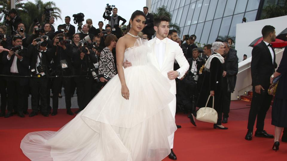 Priyanka Chopra, left, and Nick Jonas pose for photographers upon arrival at the premiere of the film The Best Years of a Life at the 72nd international film festival, Cannes, southern France, Saturday, May 18, 2019.