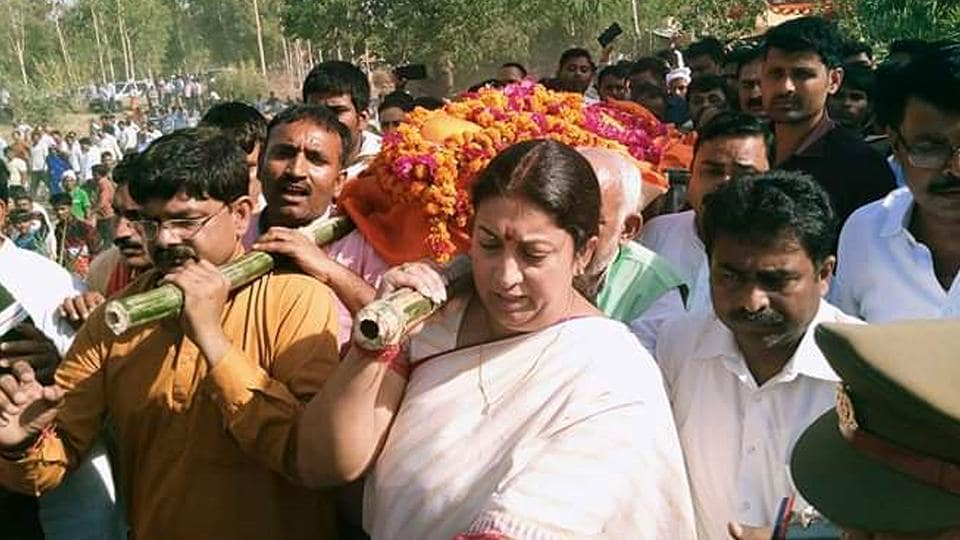BJP MP from Amethi, Smriti Irani, at the funeral procession of Surendra Singh, her close political aide.