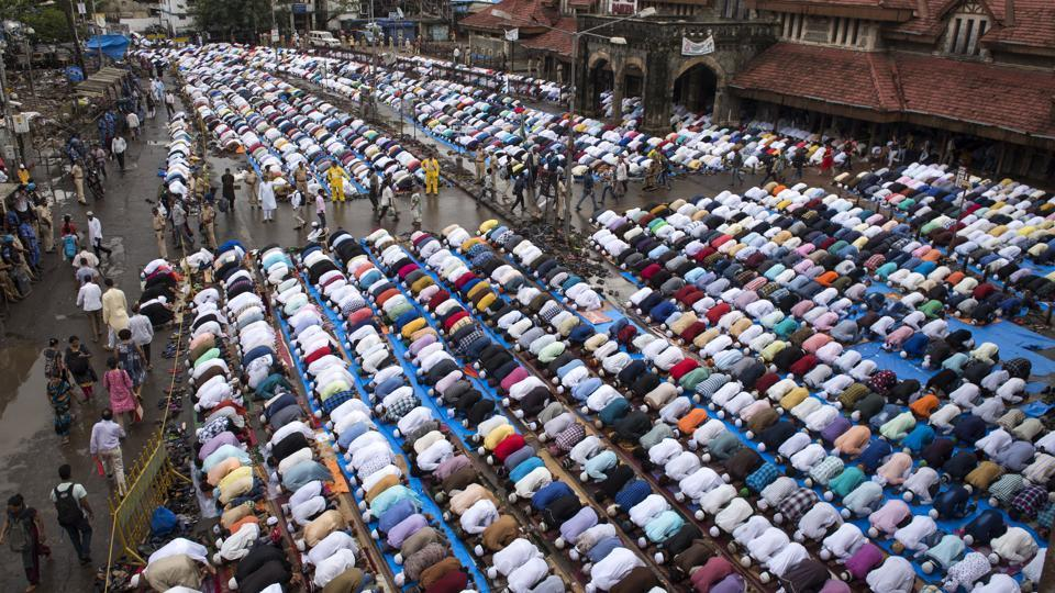 People offer prayers outside Bandra (west) station in Mumbai on the occasion of Eid Al Fitr.