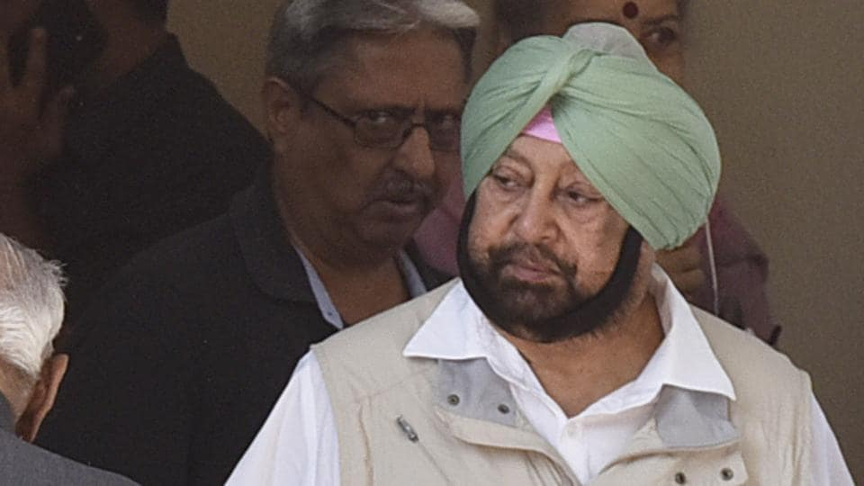 Punjab chief minister captain Amarinder Singh (L)  at AICC headquarters, in New Delhi, India, on Saturday, May 25, 2019.