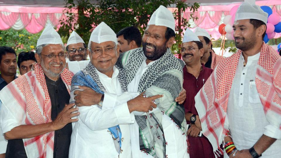 Deputy CM Sushil Kumar Modi, Bihar Chief Minister Nitish Kumar, Union Minister for Consumer Affairs, Food and Public Distribution Ram Vilas Paswan and Chirag Paswan at an Iftar party in Patna on Monday.