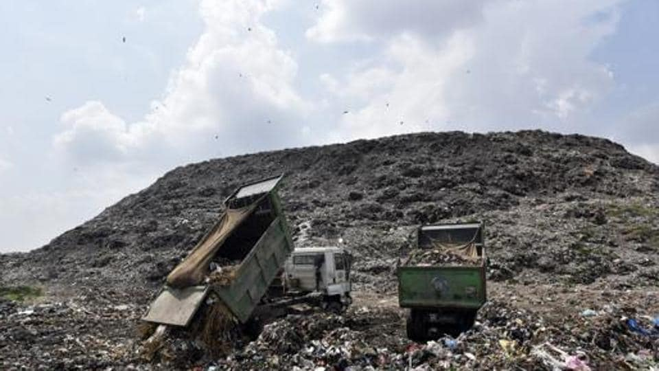 Trucks dumping garbage at Ghazipur Landfill site in New Delhi, India.