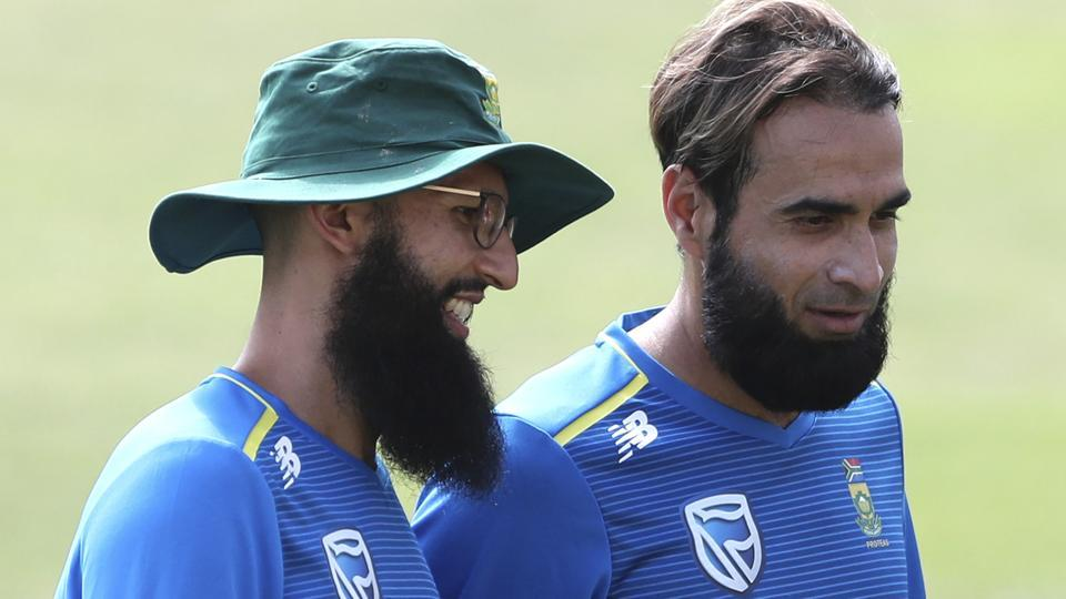 South Africa's Hashim Amla, left, and Imran Tahir attend a training session.