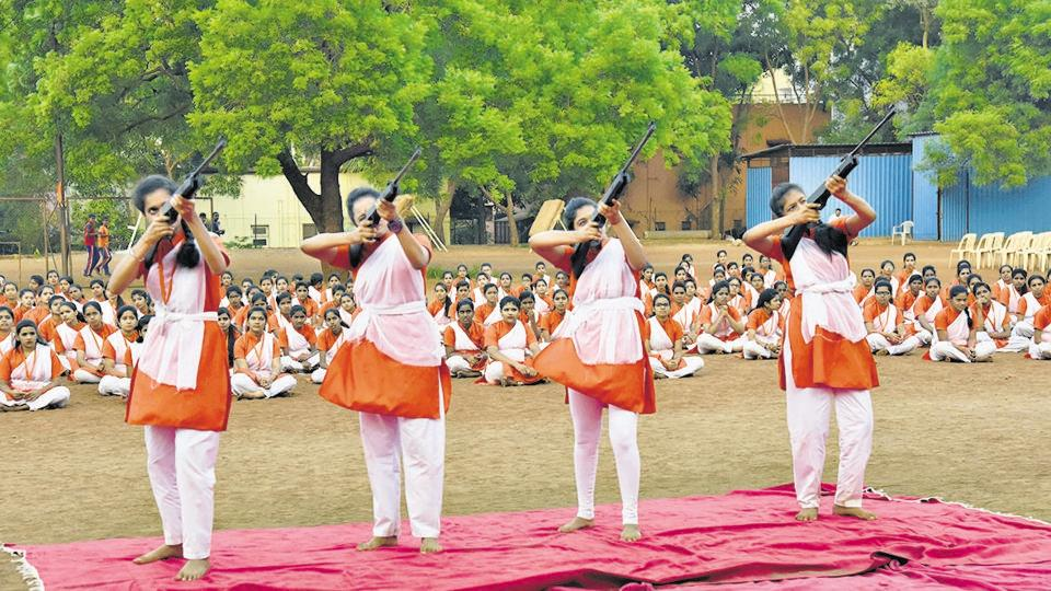 During the eight-day training session, Durga Vahini Prashikshan, VHP women's wing members participate in air rifle and sword drills, as seen in this session held on Monday. Sunday, however, members were seen brandishing rifles and swords during a public march in Nigdi.