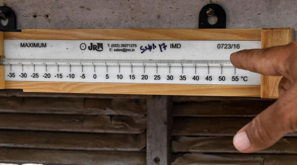 An official points a thermometer out displaying the maximum temperature recorded at the India Meteorological department office in Churu in Rajastahn on June 3, 2019. - Temperatures in the city hit 50 degrees Celsius for the second time in three days as a deadly heatwave maintained its grip on the country.
