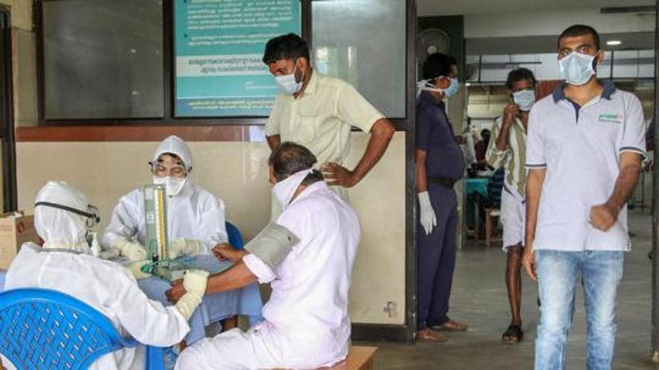 Doctors and patients wear safety masks as a precautionary measure after the 'Nipah' virus outbreak, at a Medical college, in Kozhikode, on Wednesday.