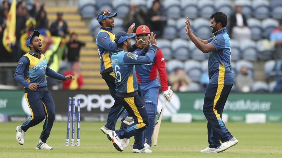Sri Lanka's Thisara Perera is congratulated by his team mates after taking the wicket of Afghanistan's Mohammad Nabi
