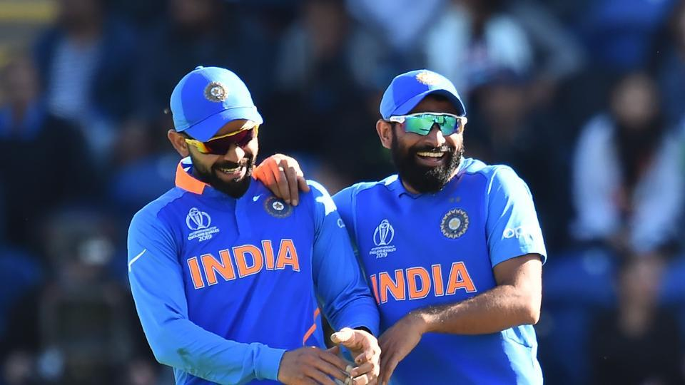 India's captain Virat Kohli (L) and India's Mohammed Shami
