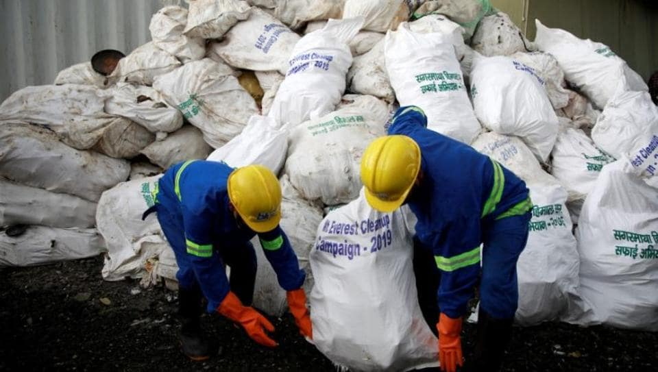 Workers from a recycling company load the garbage collected and brought from Mount Everest in Kathmandu, Nepal June 5, 2019.