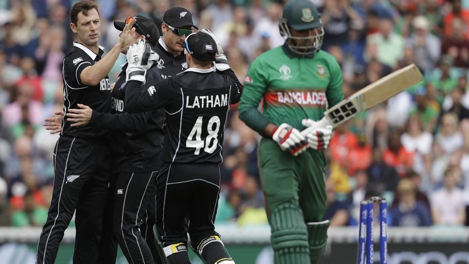 New Zealand's Matt Henry, left, celebrates taking the wicket of Bangladesh's Soumya Sarkar. (AP)