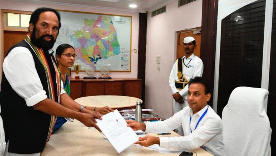 TPCC President Uttam Kumar Reddy files his nomination as MP candidate from Nalgonda. In a setback for the Congress in Telangana, 12 of its MLAs met Assembly Speaker P Srinivas Reddy and gave him a representation to merge the Congress Legislature Party with the ruling Telangana Rashtra Samithi. As 12 MLAs account for two-third of the CLP, they will not attract provisions of the anti-defection law, officials said. (ANI File)