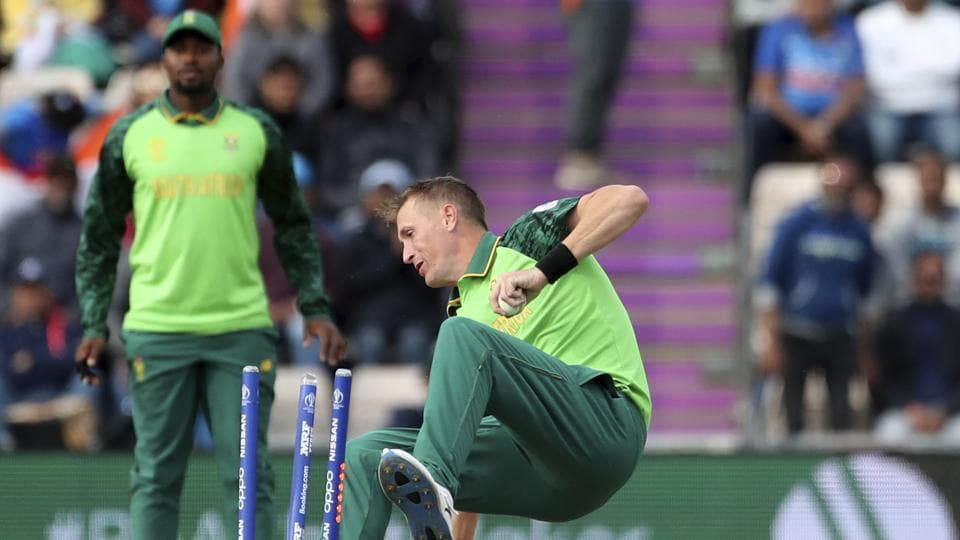 South Africa's Chris Morris falls on the stumps after taking the catch to dismiss India's MS Dhoni during the Cricket World Cup match between South Africa and India at the Hampshire Bowl in Southampton, England, Wednesday, June 5, 2019. (AP Photo/Aijaz Rahi)