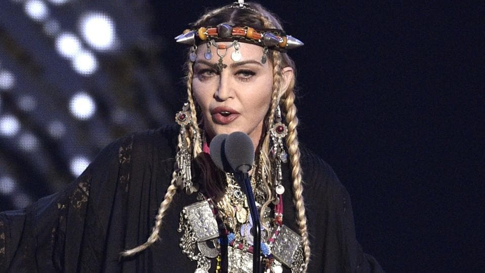 FILE - In this Aug. 20, 2018 file photo, Madonna presents a tribute to Aretha Franklin at the MTV Video Music Awards at Radio City Music Hall in New York.