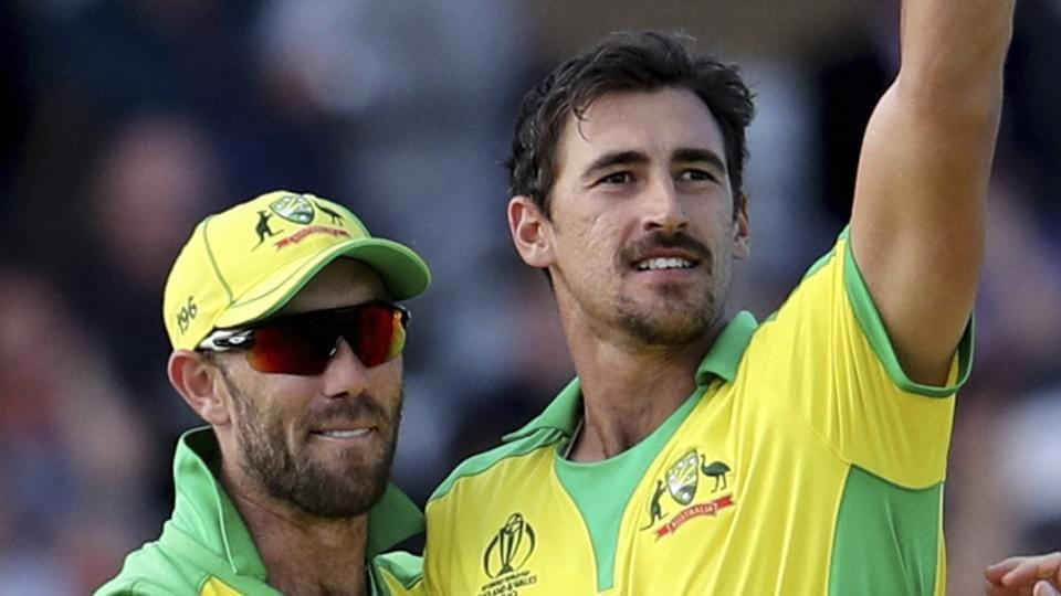 Nottingham: Australia's Mitchell Starc, center, holds up the ball to celebrate the dismissal of West Indies' Sheldon Cottrell. (AP)