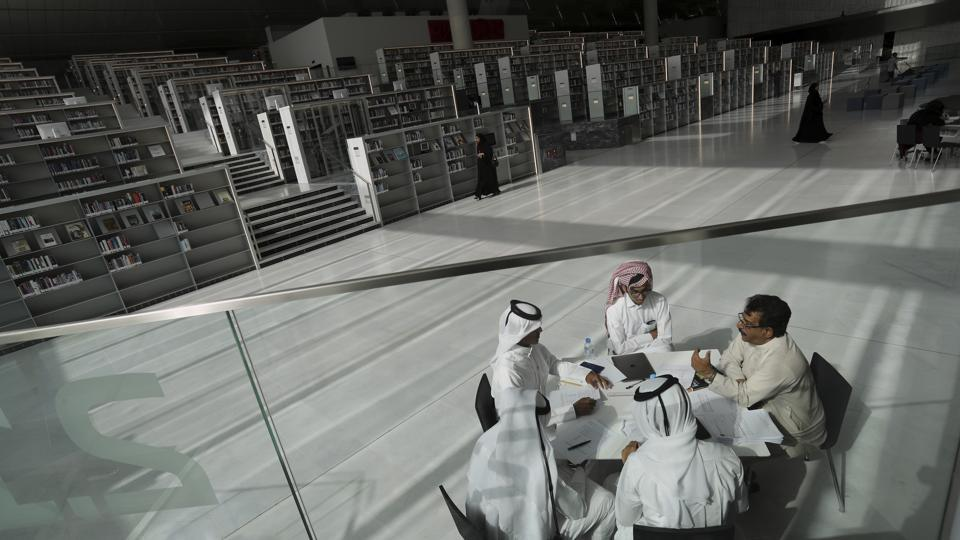 Doha's building spree continues. Students seen here listening to their professor at the Qatar National Library in Doha. The 45,000-square-meter building designed by architect Rem Koolhaas has climate-controlled display cases in the Heritage Library. (Kamran Jebreili / AP)
