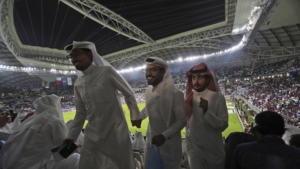 Spectators during half-time at the inauguration ceremony of the Al Janoub Stadium. The stadium has a retractable roof and a cooling system that allows hosting matches year-round, even during the country's sweltering summers. The World Cup was moved from its usual June/July dates to November 21 through December 18 because of the heat, and shortened to 28 days because of the interruption it causes to the European club season. (Kamran Jebreili / AP)