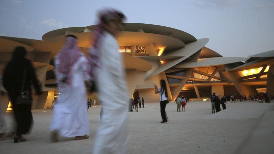 People visit the National Museum of Qatar in Doha, Qatar. Designed by French architect Jean Nouvel, it was inspired by the desert rose crystal, the buildings are shaded by clusters of large discs, while visitors enter through Islamic-style archways and opened on March 28th. (Kamran Jebreili / AP)