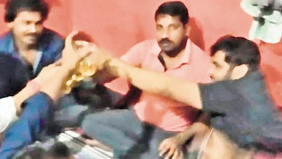 A photo of inmates in Naini Jail drinking liquor which went viral.