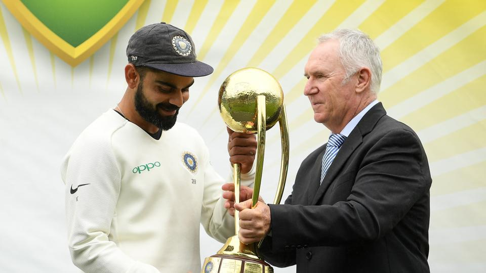 India's captain Virat Kohli recieves the Border-Gavaskar Trophy from Australia's former cricketer Allan Border following India's 2-1 series victory over Australia after play being abandoned on day five in the fourth test match between Australia and India at the SCG in Sydney, Australia, January 7, 2019.
