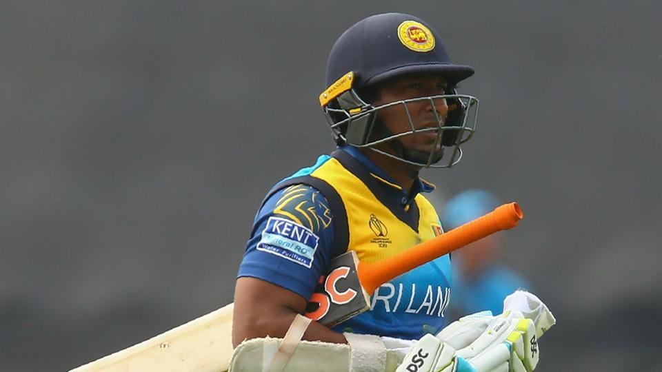 Sri Lanka's Jeevan Mendis walks back to the pavilion after his dismissal during the 2019 Cricket World Cup group stage match between New Zealand and Sri Lanka at Sophia Gardens stadium in Cardiff, south Wales, on June 1, 2019.