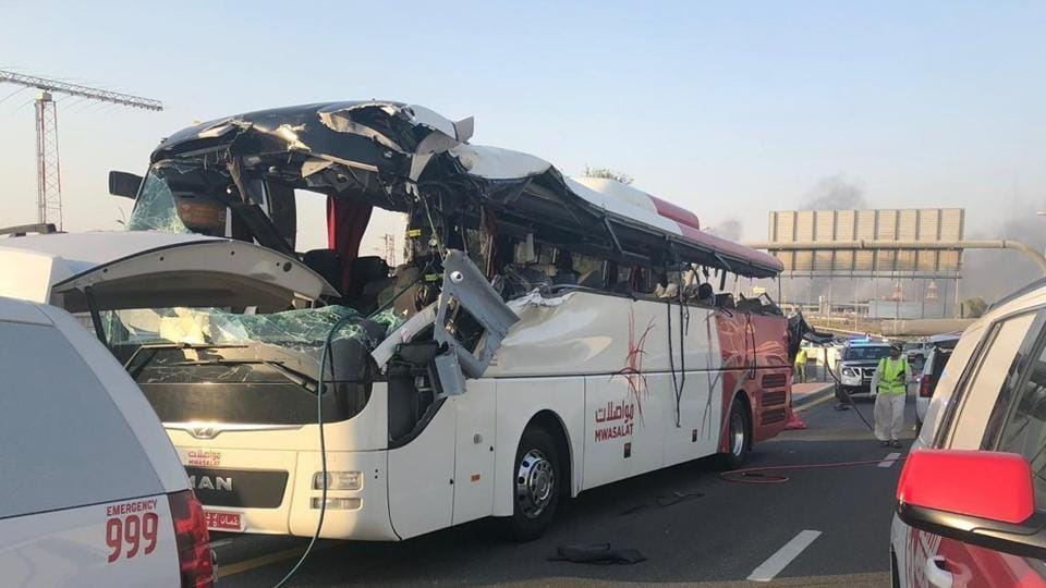 The low-clearance signboard that hangs over a car-only off-ramp of the Sheikh Mohammed bin Zayed Road, a major highway in Dubai, smashed through the left side of the bus and killed almost everyone seated on that side. (Photo Credit: Dubai Police)