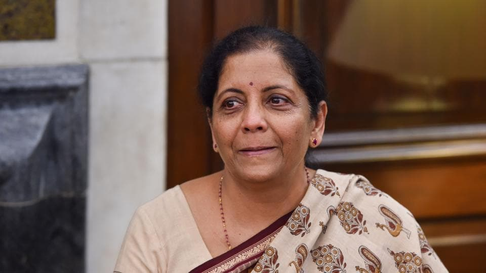 Newly-appointed Finance Minister Nirmala Sitharaman reacts emotionally as she takes charge of the Finance Ministry at North Block, in New Delhi.