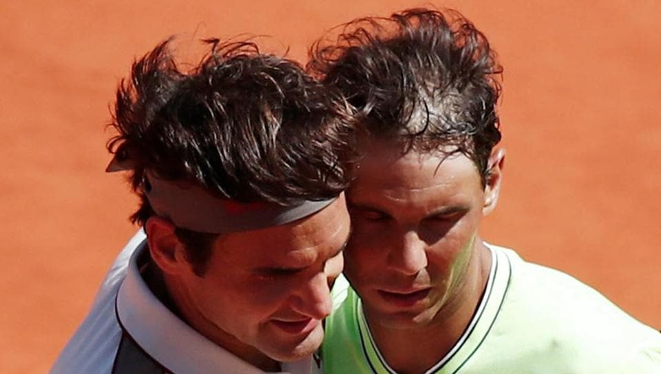 Switzerland's Roger Federer and Spain's Rafael Nadal after their semifinal match. REUTERS/Benoit Tessier TPX IMAGES OF THE DAY